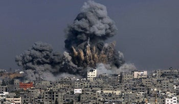 (FILES) This file photo taken on July 29, 2014 shows clouds of heavy smoke billowing into the air following an Israeli military strike in Gaza City on July 29, 2014.