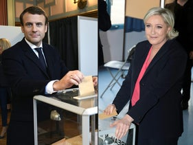 French presidential election candidate for the En Marche ! movement Emmanuel Macron (L) casting his ballot at a polling station in Le Touquet, northern France, and French presidential election candidate for the far-right Front National (FN - National Front) party Marine Le Pen casting her ballot at a polling station in Henin-Beaumont, north-western France, on May 7, 2017, during the second round of the French presidential election