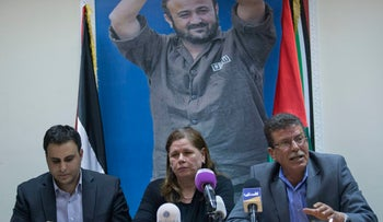 Fadwa Barghouti, back-dropped by a picture of her husband Marwan, the leader of the Palestinian prisoners' hunger strike, hold a press conference in Ramallah, West Bank, May 7, 2017.