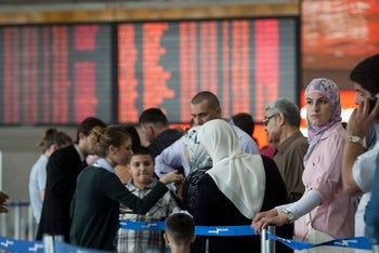Passengers line up at Ben-Gurion airport.