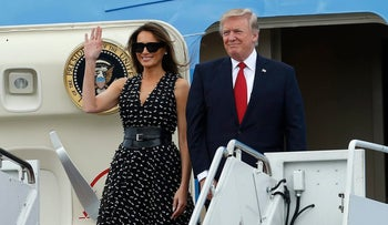 First Lady Melania Trump and U.S. President Donald Trump arrive on Air Force One at Palm Beach International Airport in Florida, April 6, 2017.