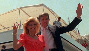 Donald Trump waves to reporters with his wife, Ivana, as they board their luxury yacht on July 4, 1988.