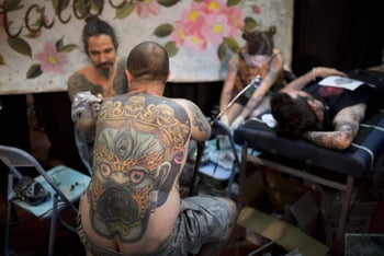A man receives a tattoo on his arm during the 4th Israel Tattoo Convention in the Israeli coastal city of Tel Aviv, on October 7, 2016.