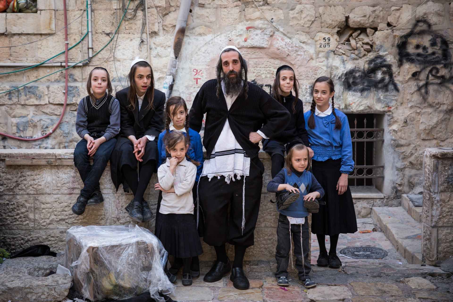 Yoelish Kraus with some of his 16 children at home in Jerusalem.