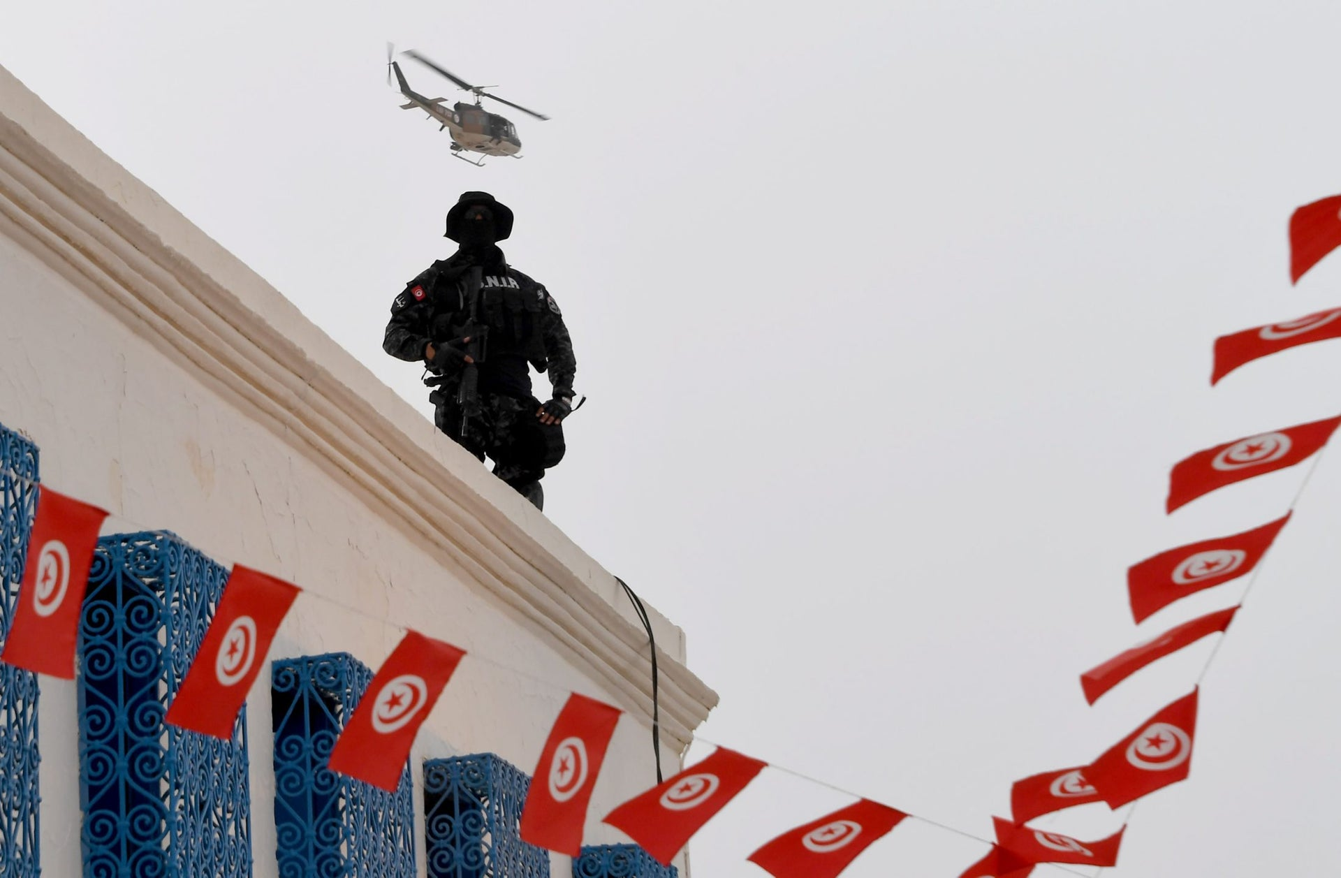 Tunisian special forces stand guard outside the Ghriba synagogue on the Tunisian resort island of Djerba on May 12, 2017 during the first day of the annual Jewish pilgrimage to the synagogue on the Mediterranean resort island of Djerba.