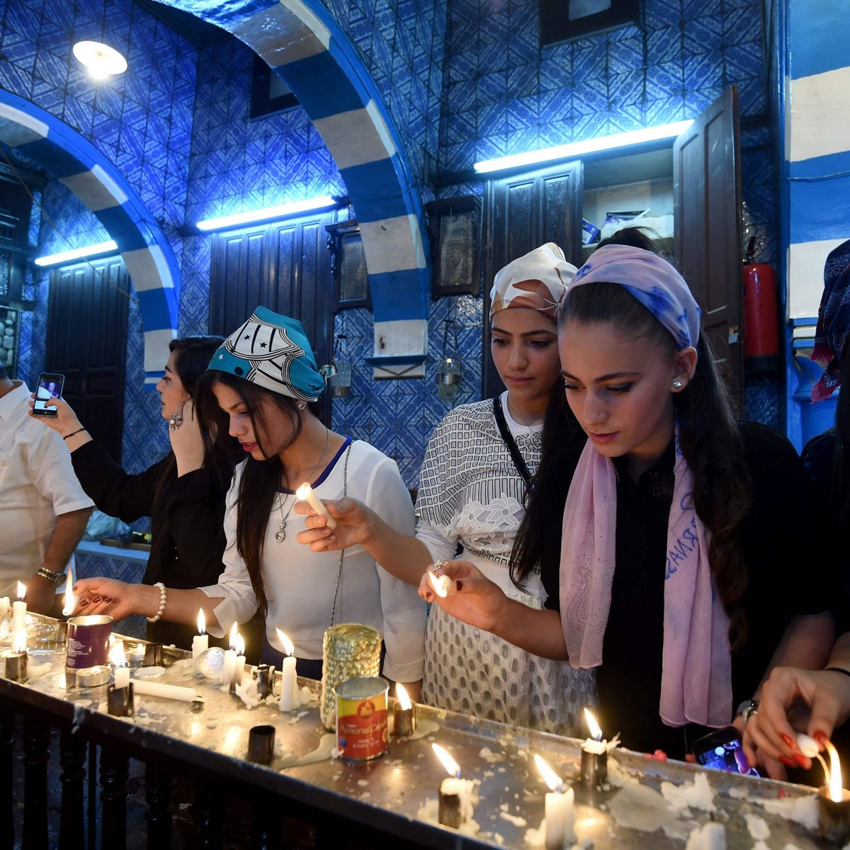 Israeli girls light candles at the the Ghriba synagogue in the Tunisian resort island of Djerba on May 12, 2017 during the first day of the annual Jewish pilgrimage to the synagogue on Tunisia's Mediterranean resort island of Djerba.