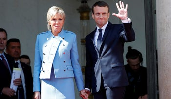 French President Emmanuel Macron and his wife Brigitte Trogneux at handover ceremony at the Elysee Palace in Paris, France, May 14, 2017.