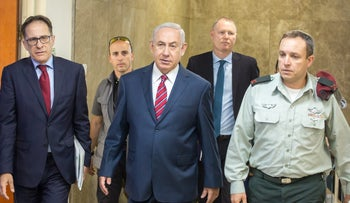 Prime Minister Benjamin Netanyahu, center, on his way into his weekly meeting, May 14, 2017.
