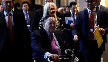 """Billionaire Sheldon Adelson, chairman and chief executive officer of Las Vegas Sands Corp., front, arrives for a keynote presentation session at the 14th CLSA Japan Forum in Tokyo, Japan, on Tuesday, Feb. 21, 2017. Japan is the """"ultimate business opportunity"""" for integrated casino resorts, Adelson said. Photographer: Kiyoshi Ota/Bloomberg"""