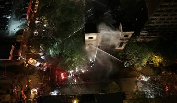 Firefighters work to contain a fire at the Beth Hamedrash Hagadol synagogue in New York City, May 14, 2017.