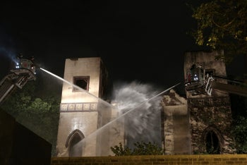 Firefighters extinguish the fire at the Beth Hamedrash Hagadol synagogue in New York City, May 14, 2017.