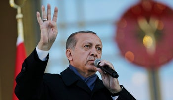 Turkey's President Recep Tayyip Erdogan, delivers a speech during a rally of supporters a day after the referendum, outside the Presidential Palace, in Ankara, Turkey, Monday, April 17, 2017.