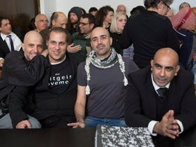 Barak Cohen (right) and members of the Ba'im Lebankim group in a court hearing in Tel Aviv in 2013.