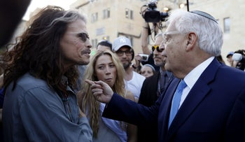 New U.S. envoy to Israel David Friedman talks with Aerosmith's lead singer Steven Tyler during a chance meeting at the Western Wall, Jerusalem, May 15, 2017.