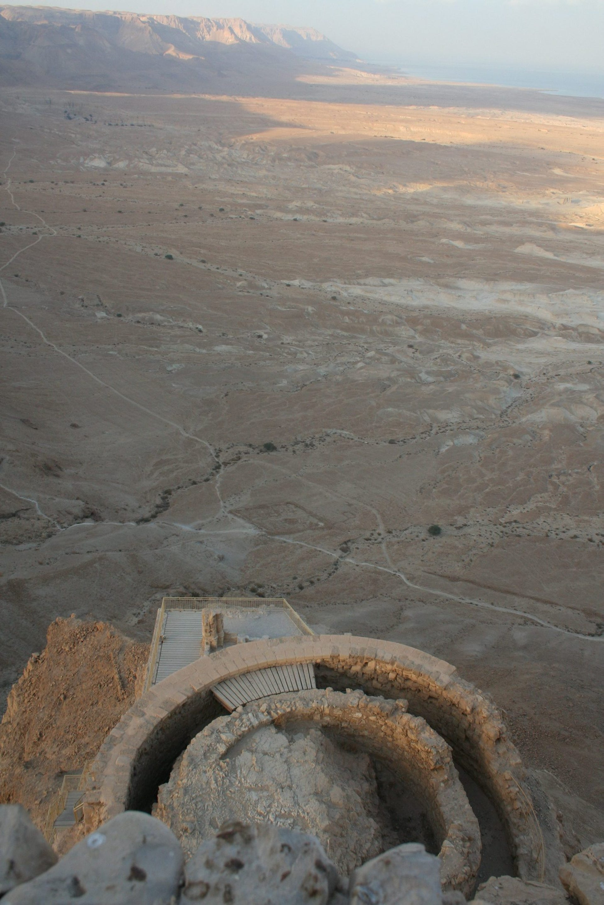 Looking down from the Masada plateau to a tower built below the fortress: The desert below is in the background.