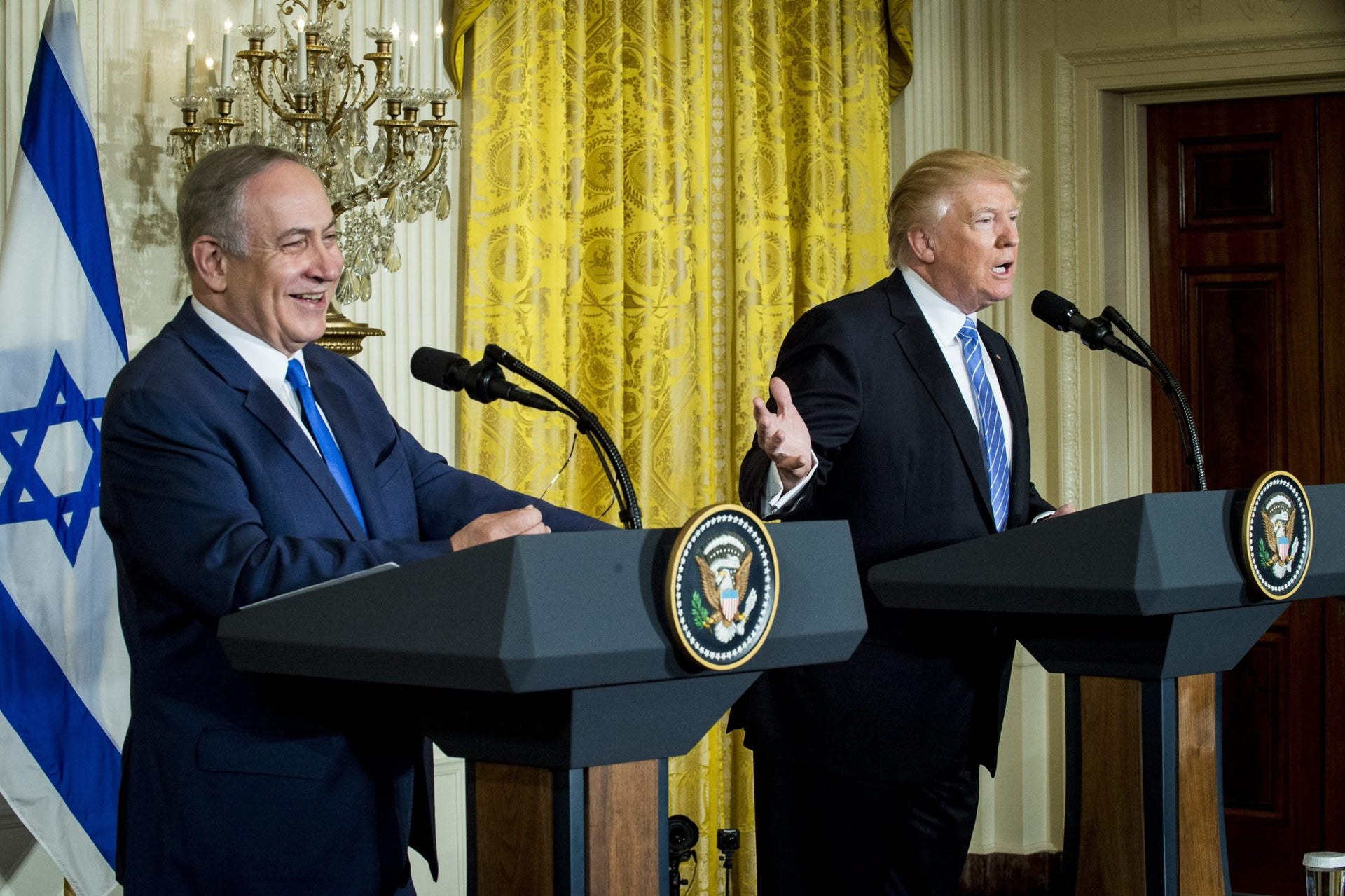 U.S. President Donald Trump, right, speaks while Benjamin Netanyahu, Israeli's prime minister, smiles during a news conference in the East Room of the White House in Washington, D.C., U.S., Feb. 15, 2017.
