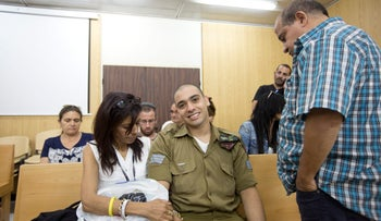 Sgt. Elor Azaria, center, with his parents in the military appeals court in Tel Aviv, May 17, 2017.