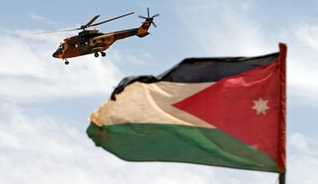 A helicopter is seen next to the Jordanian flag during the Eager Lion military exercise at the Jordan-Saudi Arabia border, south of Amman May 17, 2017.