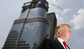 Donald Trump is profiled against his 92-story Trump International Hotel & Tower during a news conference on construction progress in Chicago, May 2007.