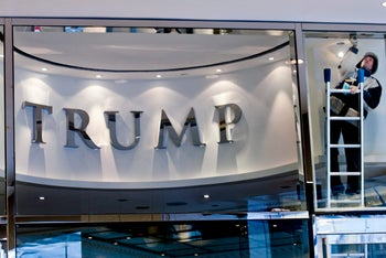 A worker puts finishing touches on the entrance to the Trump International Hotel & Tower Toronto, January 29, 2012.