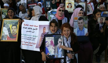 Families of Palestinians imprisoned in Israeli jails demonstrate in front of the Red Cross offices in East Jerusalem, May 17, 2017.