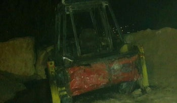 A tractor torched in Burin, in the  West Bank.
