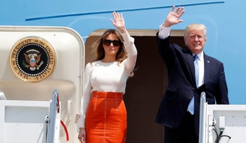 President Donald Trump and first lady Melania Trump, wave as they board Air Force One at Andrews Air Force Base, Md., Friday, May 19, 2017