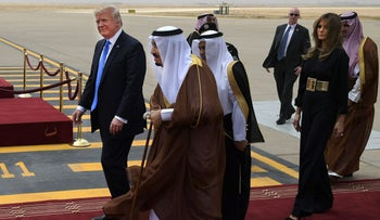 President Donald Trump is welcomed by Saudi King Salman bin Abdulaziz al-Saud upon arrival at King Khalid International Airport in Riyadh on May 20, 2017, followed by First Lady Melania Trump.
