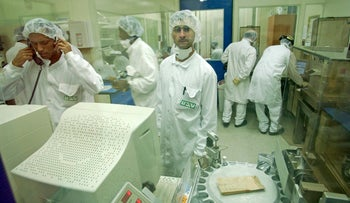 Workers inside a Teva production plant.