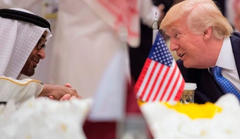 A handout picture provided by the Saudi Royal Palace on May 21, 2017, shows Abu Dhabi Crown Prince Mohammed bin Zayed al-Nahayan (L) chatting with US President Donald Trump during a meeting with leaders of the Gulf Cooperation Council at the King Abdulaziz Conference Center in Riyadh.