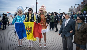 Participants of the Russian-speaking LGBT pride parade hold the flag of Moldova on the Brighton Beach boardwalk, Brooklyn, May 20, 2017.