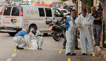 Israeli forensic police inspect the scene of a stabbing attack in the Israeli coastal city of Netanya on May 23, 2017.
