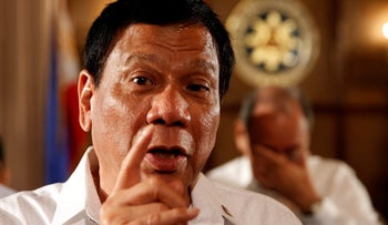 Philippine President Rodrigo Duterte talks to reporters after a news conference at the presidential palace in Manila, Philippines, March 13, 2017.