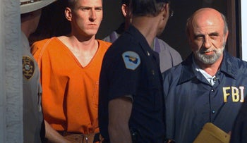 Timothy McVeigh being led out of a courthouse after being arrested for the Oklahoma City bombing in 1995 that killed 168 people.