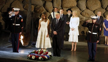 U.S. President Donald Trump and his wife Melania at a wreath laying ceremony during a visit to the Yad Vashem Holocaust Memorial museum in Jerusalem May 23, 2017.