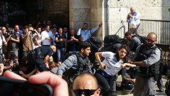 Police forcibly remove leftist protesters, outside Jerusalem's Damascus Gate, May 24, 2017.