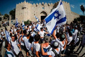 Far-right Israeli supporters wave the Israeli flag at the 'Flag March,' Jerusalem, May 24, 2017.