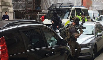 Police from the Tactical Aid Unit prepare to enter Granby House apartments in Manchester England, in connection to Monday's Manchester explosion, May 24, 2017.