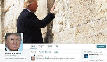 Donald Trump's personal Twitter account with a photo of the president at the Western Wall