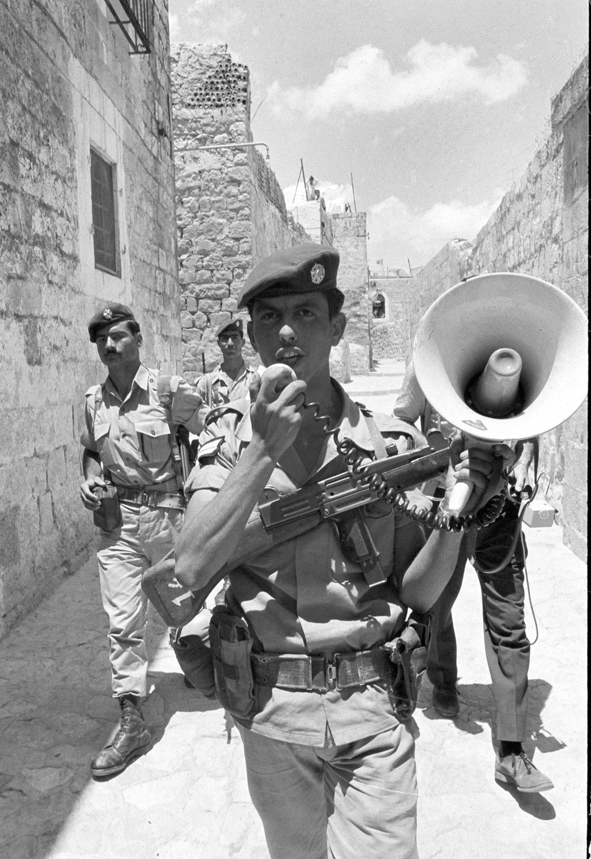 Israeli border police announce the start of a curfew in the sector of Jerusalem formerly held by Jordan, June 26, 1967.