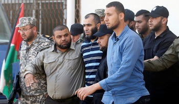 An alleged collaborator with Israel is escorted by Palestinian security forces, Gaza City, May 21, 2017.