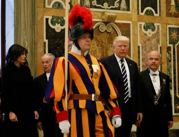 U.S. President Donald Trump and first lady Melania Trump pass a Swiss Guard as they arrive at the Vatican, May 24, 2017.
