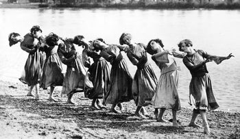 Pupils in Mary Wigman's dance studio dancing on the banks of the Rhine, 1910.