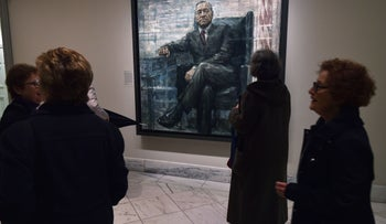 """Museum goers view a new portrait of actor Kevin Spacey in his role as """"House of Cards"""" President Francis J. Underwood at the National Portrait Gallery on February 24, 2016."""