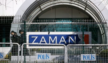 Riot police officers at the headquarters of Zaman newspaper in Istanbul, Sunday, March 6, 2016.Police used tear gas and water cannons for a second day running to disperse hundreds of protesters who gathered outside Zaman newspaper headquarters.
