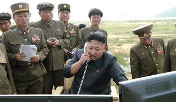 North Korean leader Kim Jung Un guides the test fire of a tactical rocket in this undated file photo released by North Korea's Korean Central News Agency (KCNA) in Pyongyang August 15, 2014.