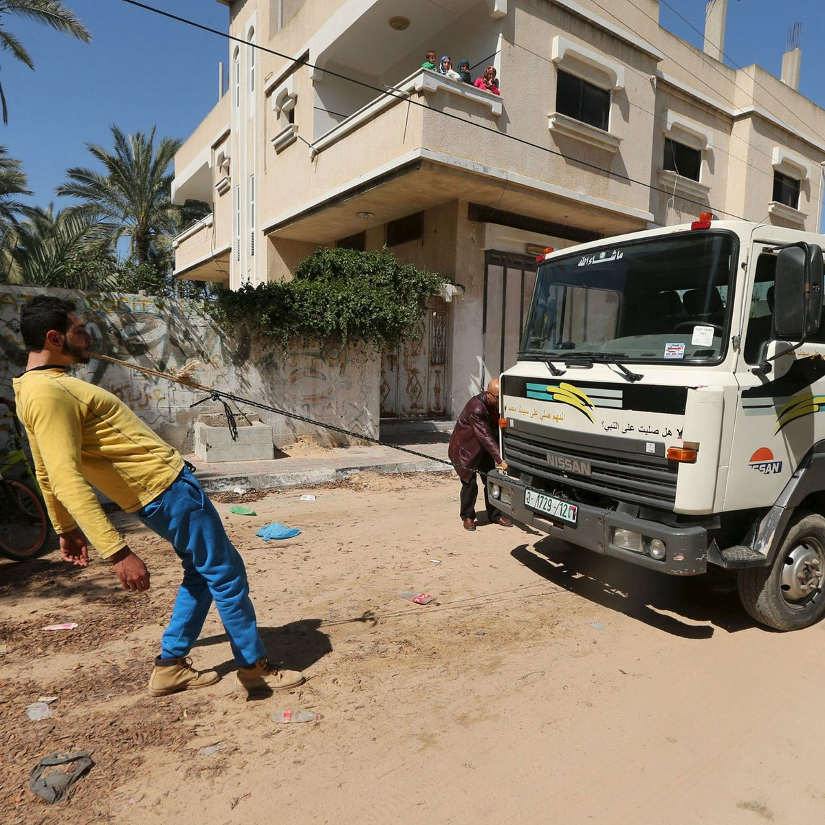 Palestinian Mohammad Baraka, 20, nicknamed by people as Gaza Samson, pulls a water tanker by a rope attached to his teeth as he exercises in Deir al-Balah in the central Gaza Strip March 5, 2016.
