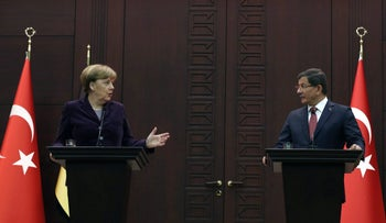 German Chancellor Angela Merkel, left, speaks to the media during a joint news conference with Turkish Prime Minister Ahmet Davutoglu in Ankara, Turkey, February 8, 2016.