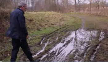 Mayor Klaus Langer of Quarnbek, Germany, at the site where the vehicle, ostensibly carrying two Israeli Mossad agents, was extricated from the mud in mid-December, 2015.