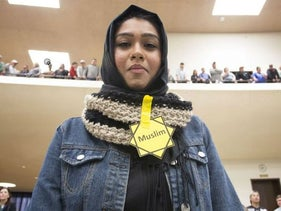 Rabya Ahmed listens as Republican presidential candidate Donald Trump makes a speech at a campaign rally on March 5, 2016 in Wichita, Kansas